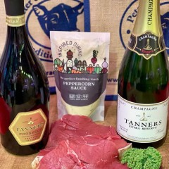 Two prime beef steaks with Prosecco