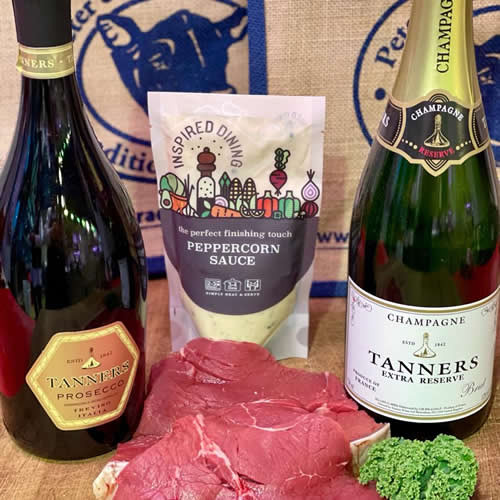 Two prime beef steaks with Champagne